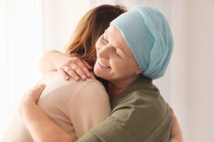 cancer patient embracing loved one