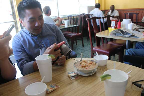 Food blogger Ricky Ly snaps a photo of the house gumbo at King Cajun on Mills