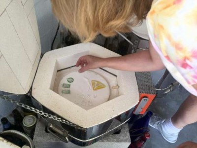 Michelle Palenik puts the jewelry into a kiln to make necklaces with cremated remains.