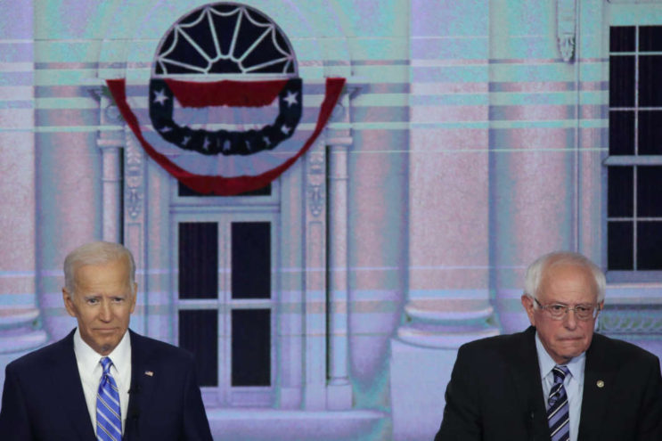 Former Vice President Joe Biden, left, and Sen. Bernie Sanders of Vermont stand next to each other during the second night of Democratic presidential debates.