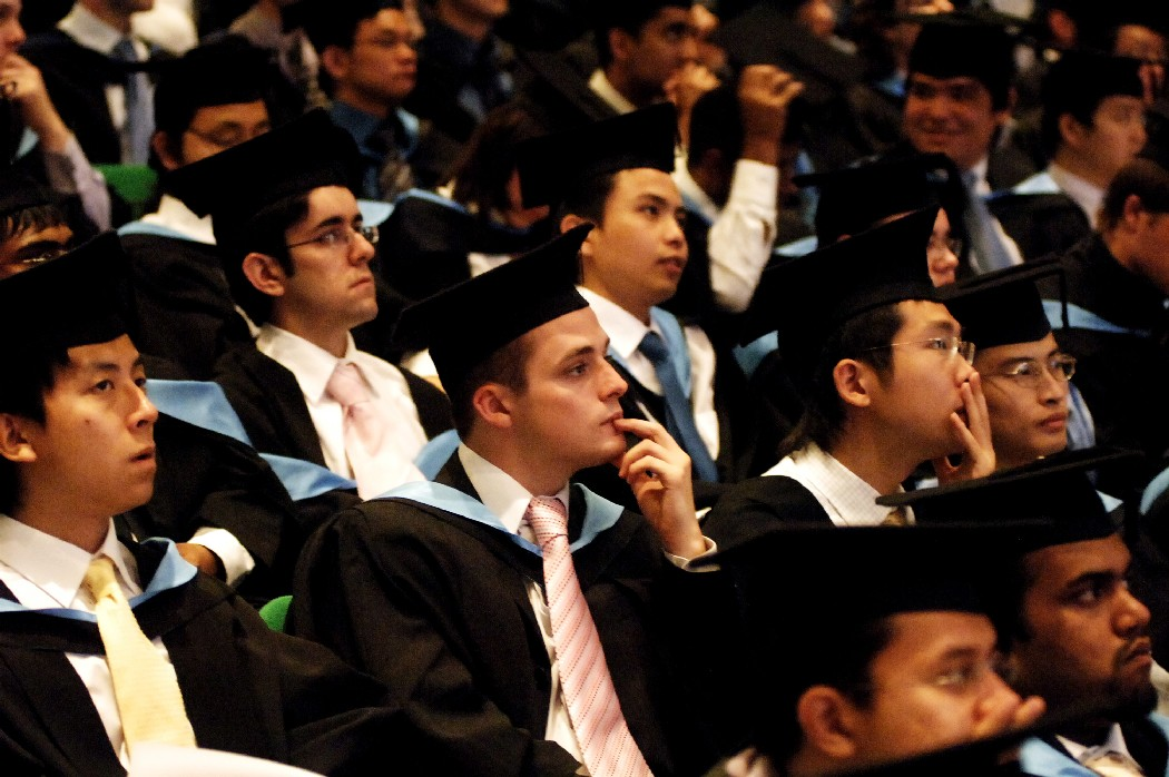 Graduates in gowns and mortarboards at graduation ceremony