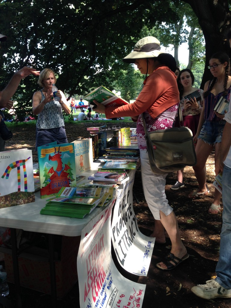 Handing out books to passersby. Credit: Melissa Rosati