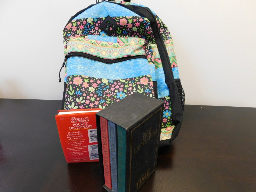 A picture with a backpack and books