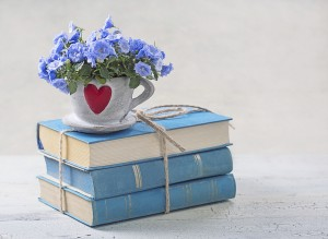 Pile of blue books and flowers