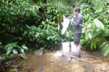 Chris pausing fishing to swat mosquitos