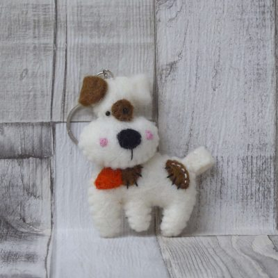 Sweet brown and white dog keyring to add a little woof to your life. Handmade and embroidered in Nepal from 100% wool felt.