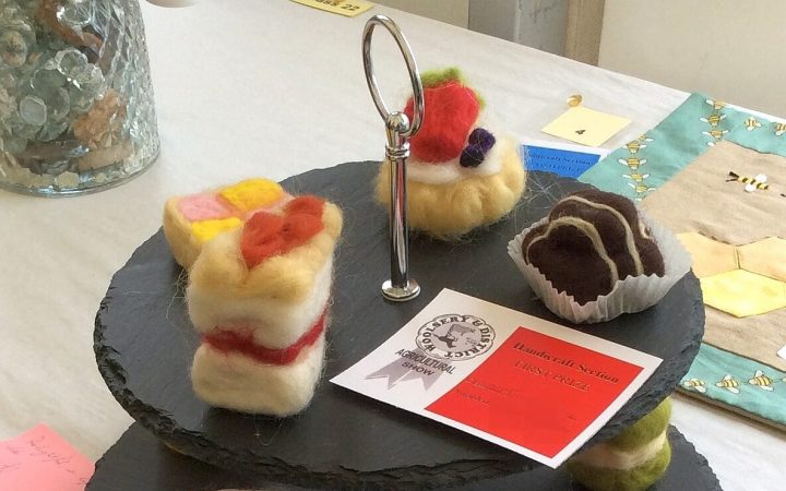 """Photo of needle felted cakes - 1st prize in the """"table centrepiece"""" class at the local country show! Great gift for cooks and slimmers alike. The craft of needle felting can be learned at Wobbly Pins."""