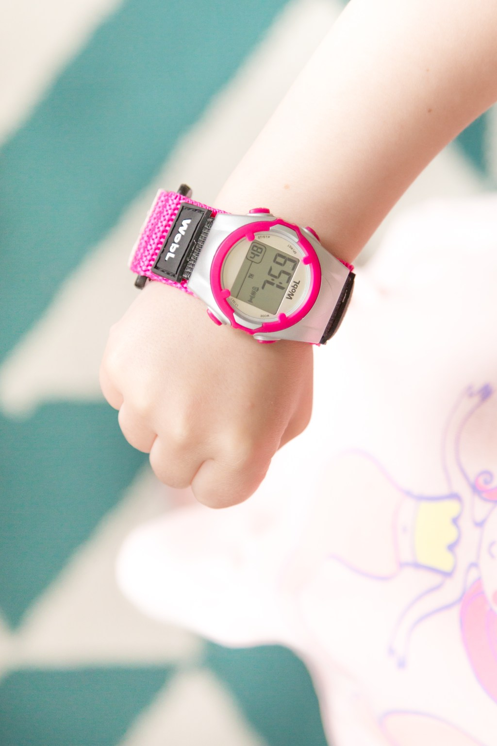 Pink WobL watch on young child's wrist