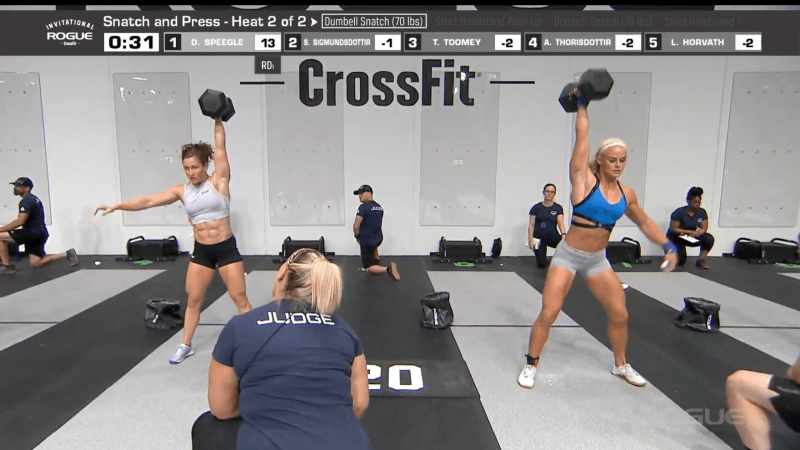 Tia-Clair Toomey and Sara Sigmundsdottir are in first and second place, respectively, on the overall leaderboard. Here, they complete their 70-lb single dumbbell snatches.
