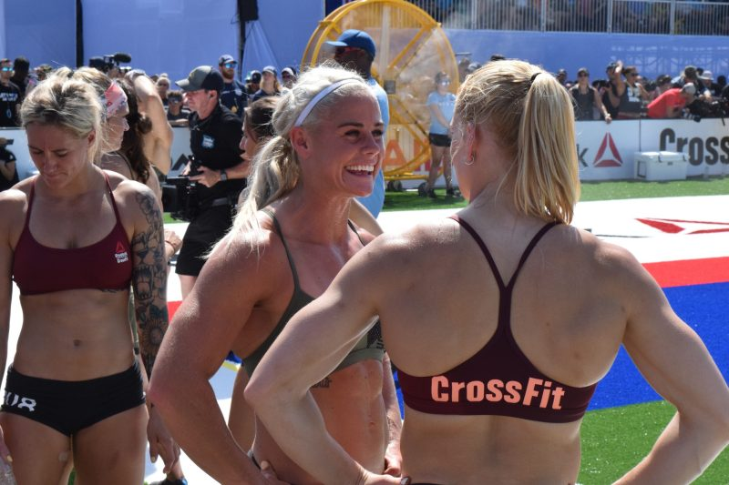Annie Thorisdottir and Sara Sigmundsdottir talk between heats of the Sprint event at the 2019 CrossFit Games