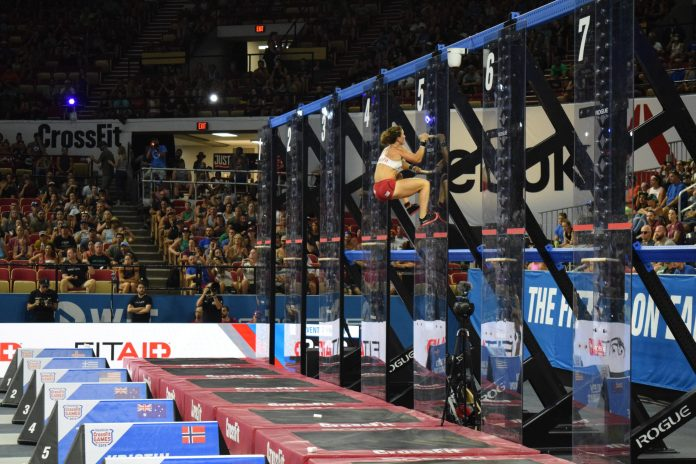 Tia-Clair Toomey of Australia with a significant lead up the pegboards in the Coliseum at the 2019 CrossFit Games.