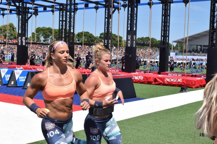 Mekenzie Riley races Amanda Barnhart out of the stadium at the 2019 CrossFit Games