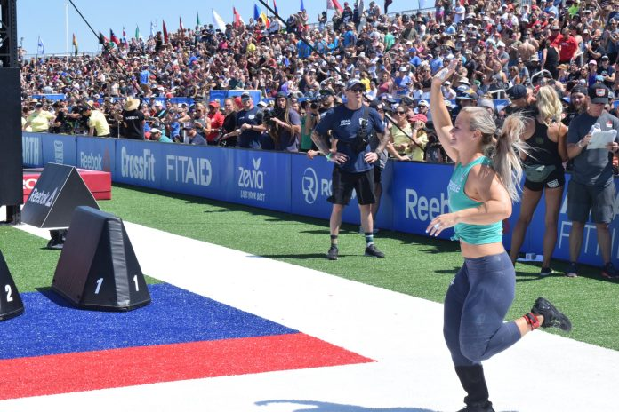 Dani Speegle waves to the crowd as she enters the stadium for the 2019 CrossFit Games
