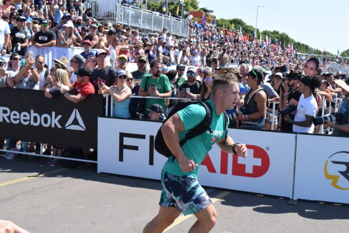 Adrian Mundwiler completes the Ruck Run event at the 2019 CrossFit Games.