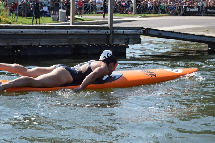 Bethany Shadburne of Streamline CrossFit completes the Swim Paddle event at the 2019 CrossFit Games