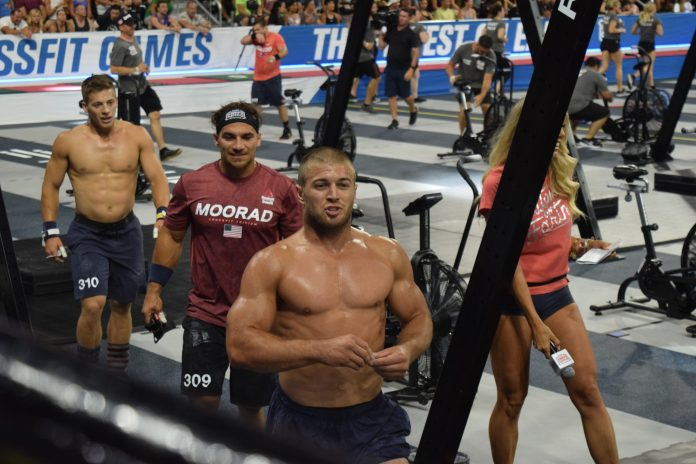 Jacob Heppner leaves the floor of the coliseum after completing an event at the 2019 CrossFit Games.