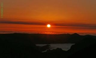 Sonnenuntergang hinter dem Wolkenmeer