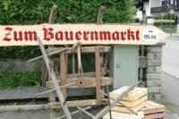 Woiga.de Schild zum Bauernmarkt in Wallgau