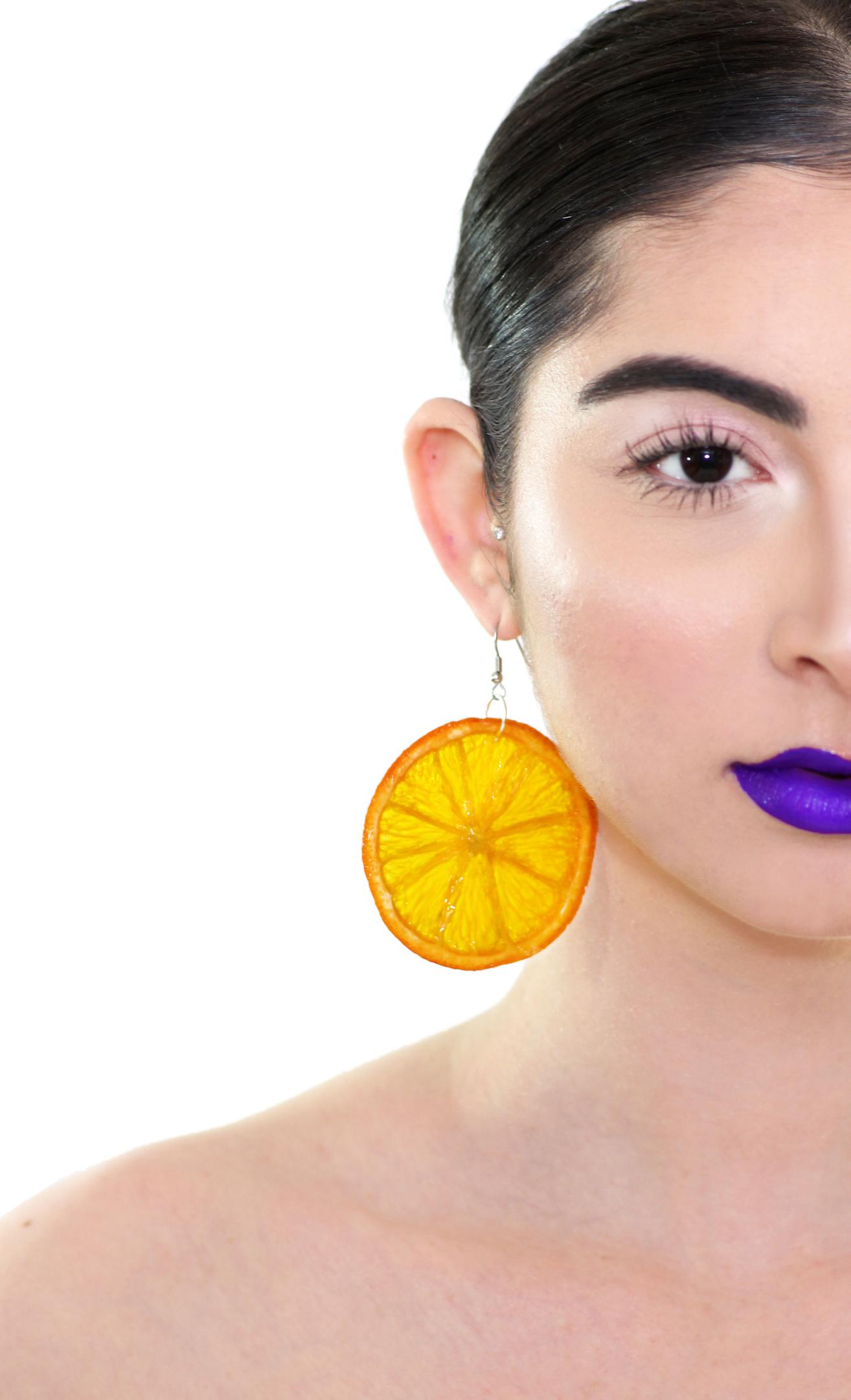 Orange Earrings on model