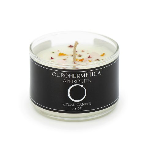 3.6 ounce white candle in clear glass jar with black OuroHermetica label with white ouroboros icon