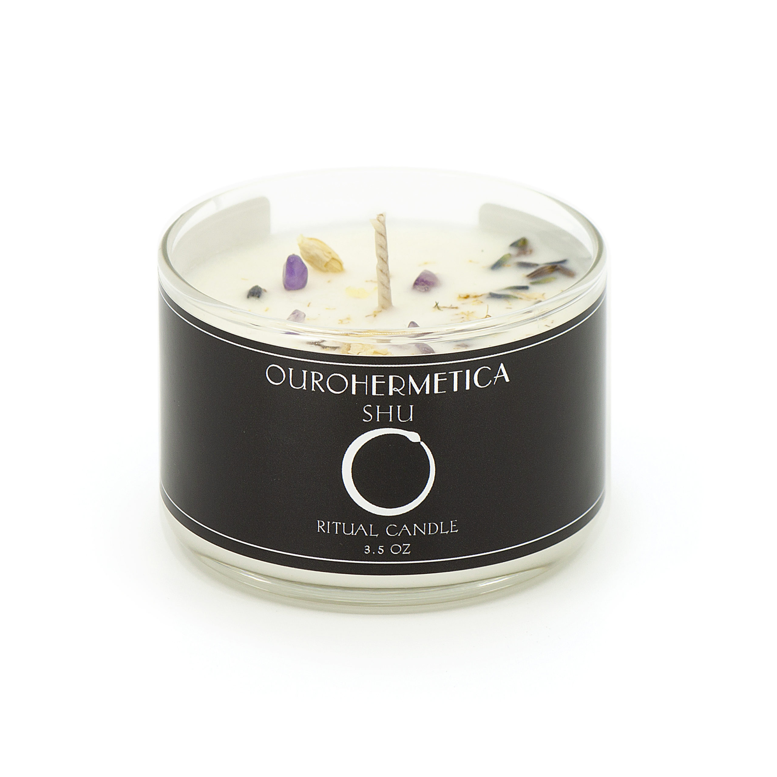 3.6 ounce candle in clear jar with black OuroHermetica label with white ouroboros icon