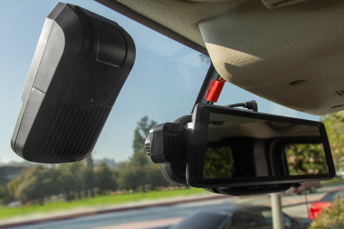 WOLFCOM front-facing in-car camera mounted on a windshield