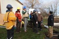 Crew meeting. From left: Mikaela, architect; Steve, builder; Ian, timber-framer; Malcolm, Passive House specialist; Anne, builder; David, home-owner; Chris, head builder.