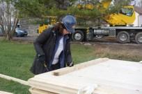 Anne preparing the roof panels by prefixing screws...