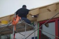 Steve fitting the Schneiderholz Multitherm 110 underlayer in the eaves