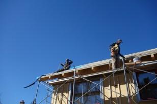 Installing the membrane, under blue skies