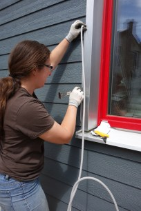 Anne lines the join between siding and trim