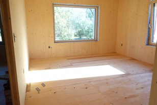 Bright evening sun in on the new subflooring in the west upstairs bedroom