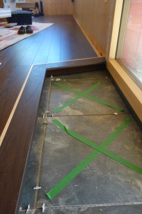 The tiled are for shoes by the sliding door