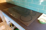 Checking how the cooktop fits its cut-out