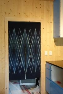 Indigo noren between the kitchen and pantry