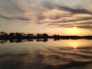 """""""Heaven meets earth"""" Sunset over the Okavango on the Namibia/Angola border..."""