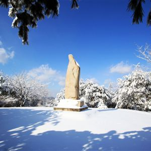 Boulder that looks like Jesus or a woman standing in the snow in Wolmyeongdong