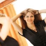 woman looking in mirror by Fotolia