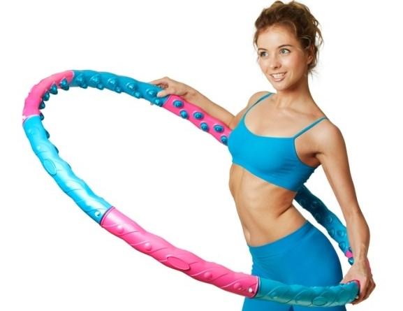 Vrei un antrenament distractiv? 8 motive pentru a încerca Hula Hooping
