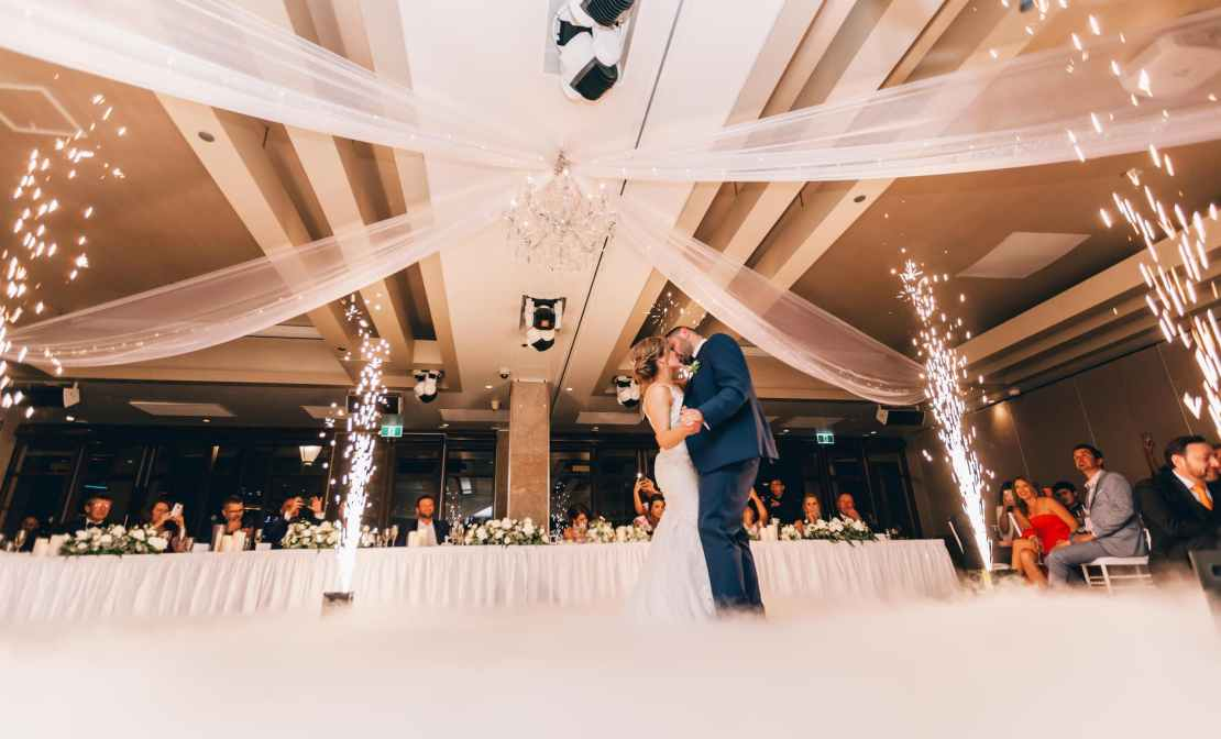 low angle photography of bride and groom dancing