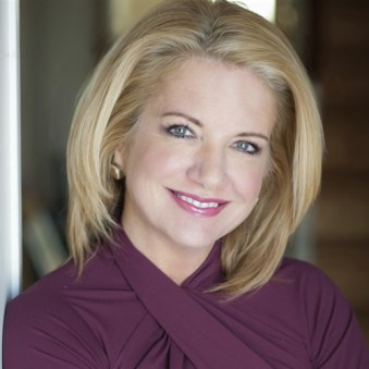 Headshot of Tracy Davidson, 11 time Emmy Award-winning journalist.