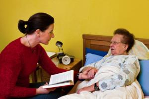 Sick elderly woman is visited