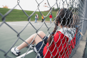 Kid girl left out excluded foster group sad student
