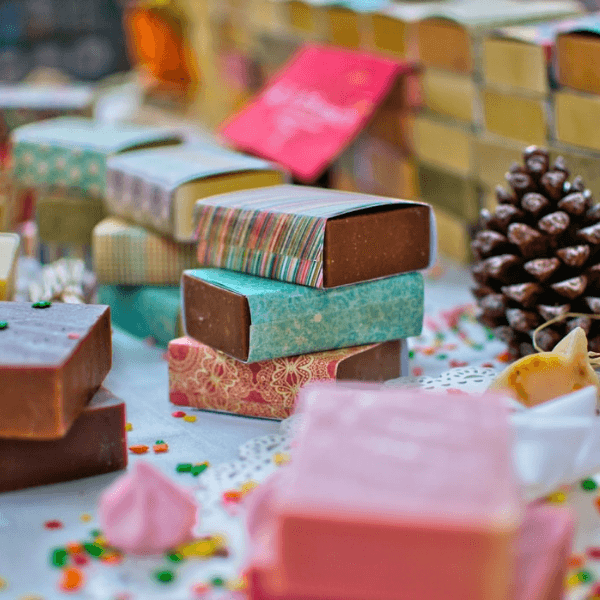 A stack of 3 chocolate bars wrapped in colorful paper.