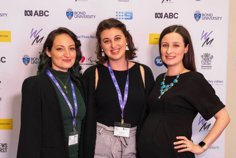 Women in Media Queensland volunteers Jocelyn Garcia, Anna Levy, and Felicity Caldwell. Photo: Monique Grisanti | Uneek Creative