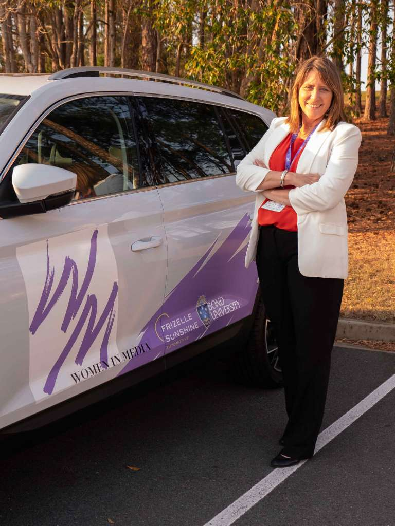 Women in Media co-chair Kathy McLeish with our special cars to transport speakers. Thanks Frizelle. Photo: Monique Grisanti | Uneek Creative