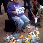 Hedy Epstein surrounded by school supplies during the Gaza Freedom March