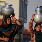 Pakistan women carry water home - Islamabad