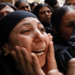 Egypt Coptic woman cries at mass funeral