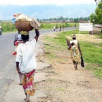 Burundi women walking on road